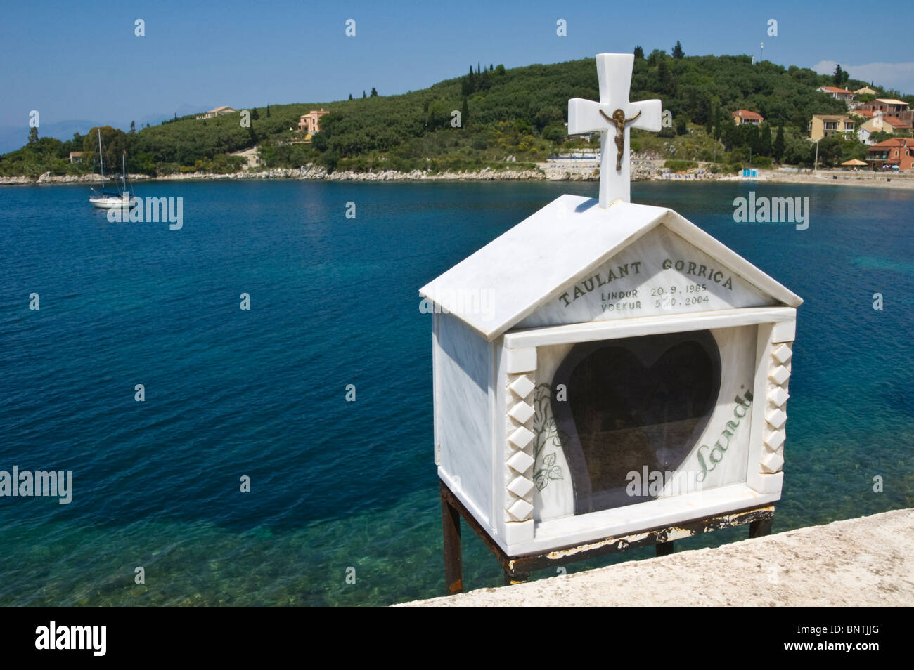 Roadside shrine overlooking bay at Kassiopi on the Greek Mediterranean island of Corfu Greece GR Stock Photo