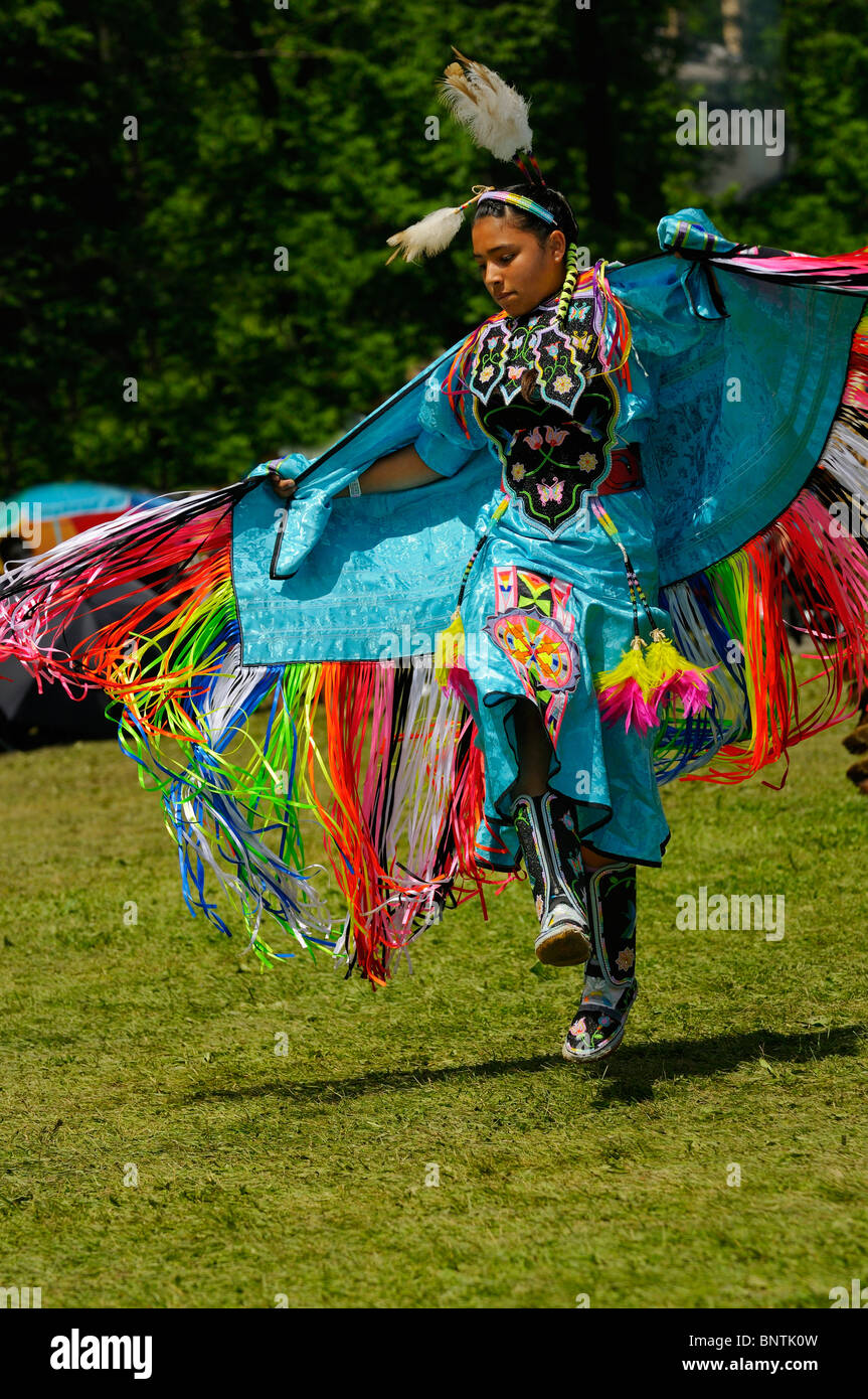 Young Native Indian girl airborne in the Fancy Shawl Dance competition at the Six Nations Reserve Pow Wow Grand - Stock Image