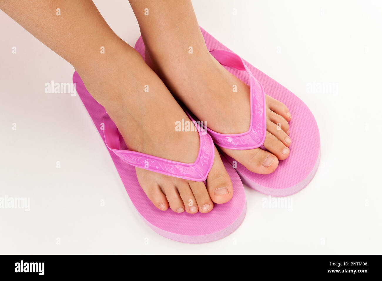 Pink flip flop sandal with white background - Stock Image