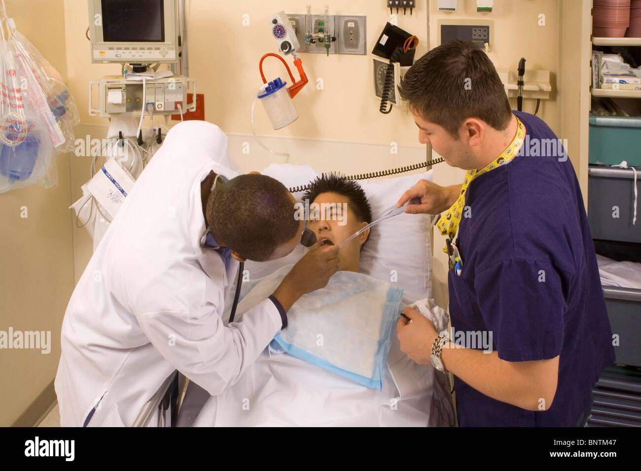 Emergency room physician (left) examines teen drug overdose
