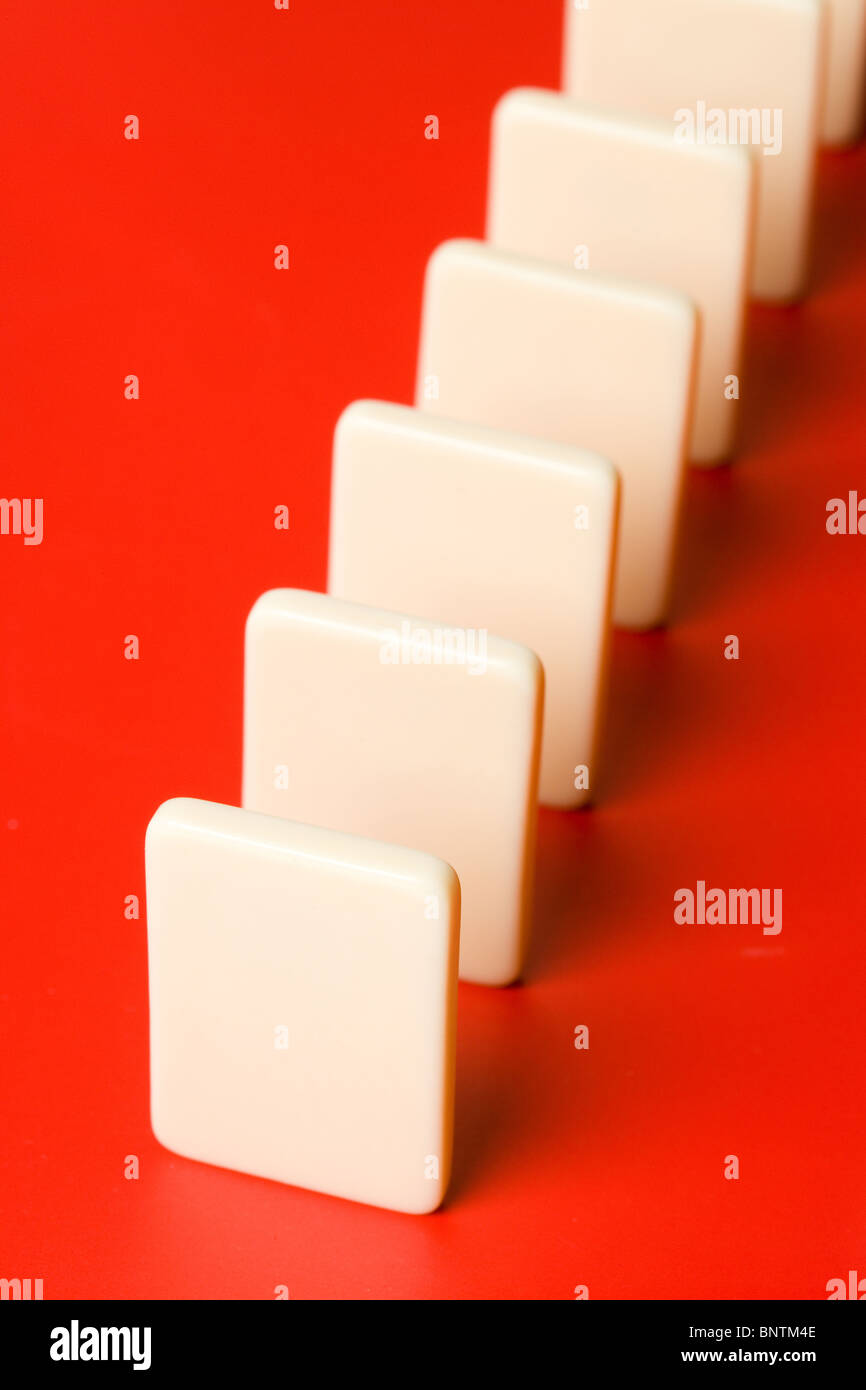 Domino with red background, Concept of Cause or Teamwork - Stock Image