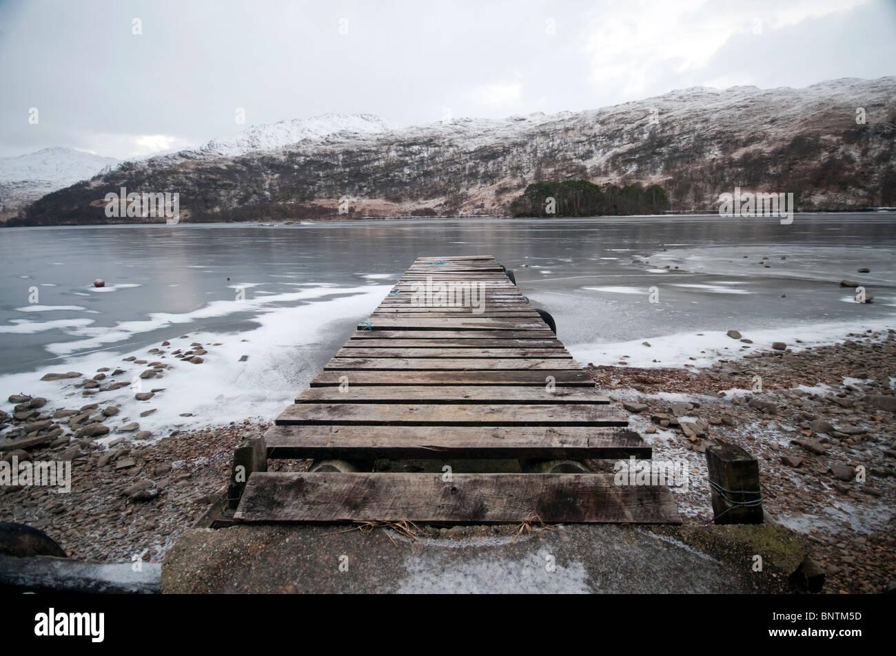 A frozen Jetty on a frozen Loch - Stock Image