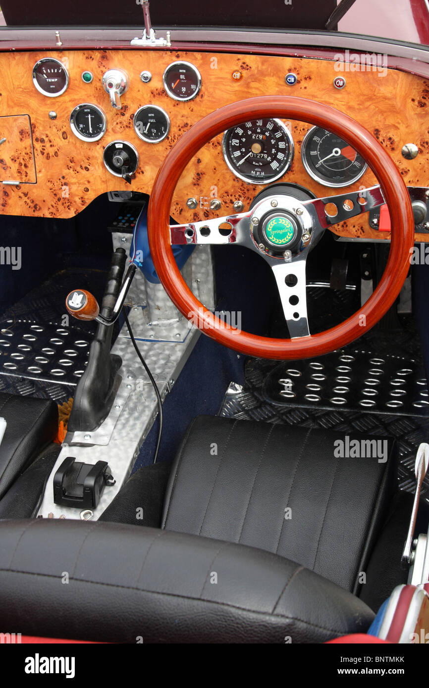 A classic car dashboard and interior. - Stock Image