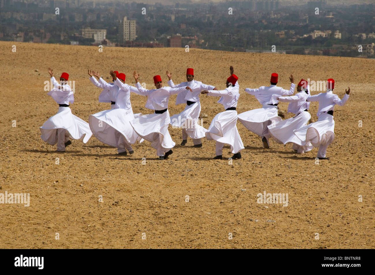 whirling dervish Sufi dancers in motion on the Giza plateau in Cairo Egypt - Stock Image