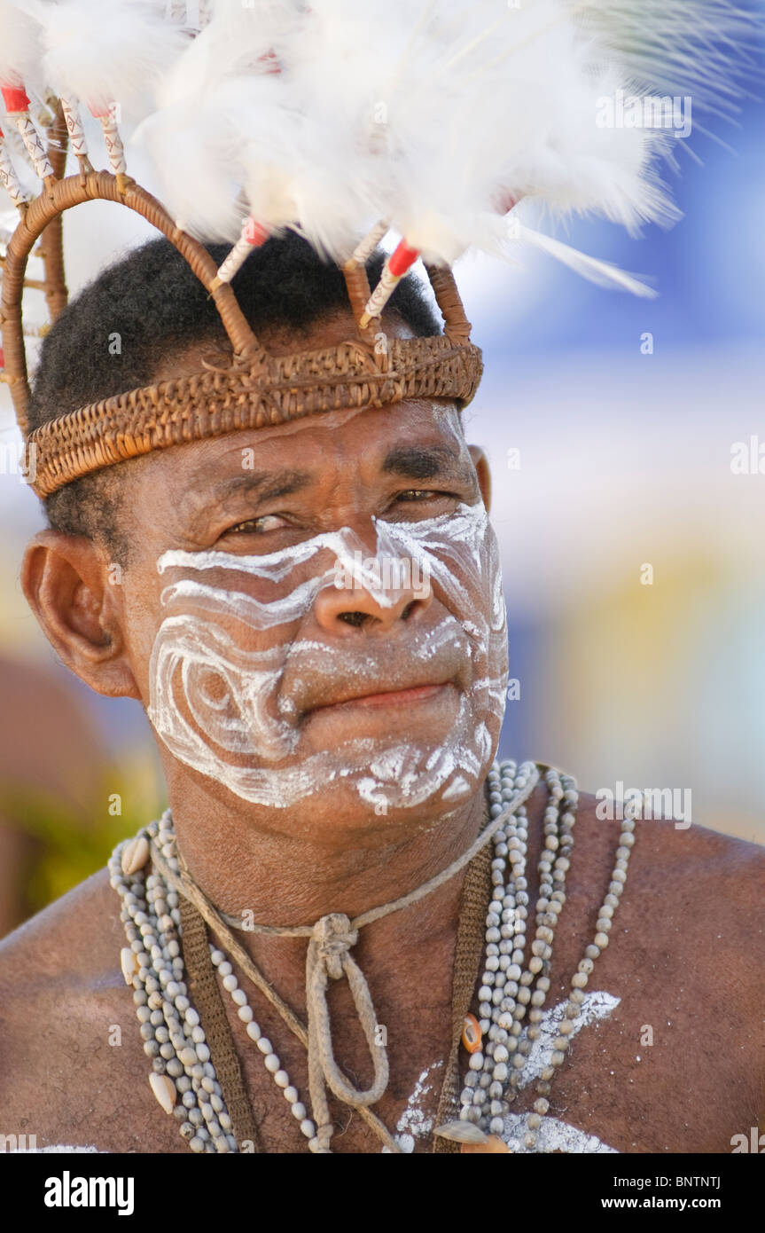 Portrait of Papuan with a traditional headdress - Stock Image