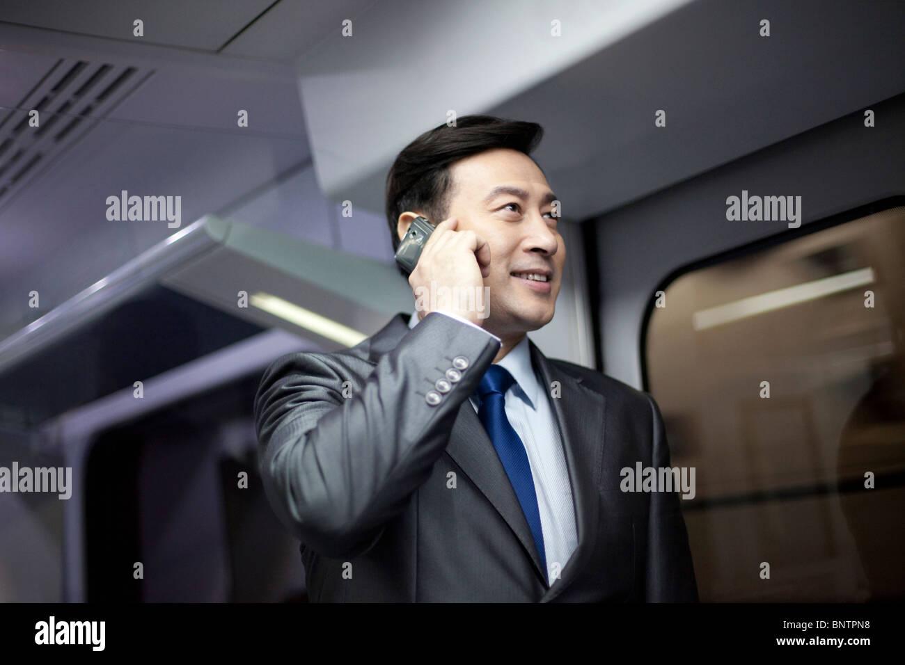 Businessman on the subway - Stock Image