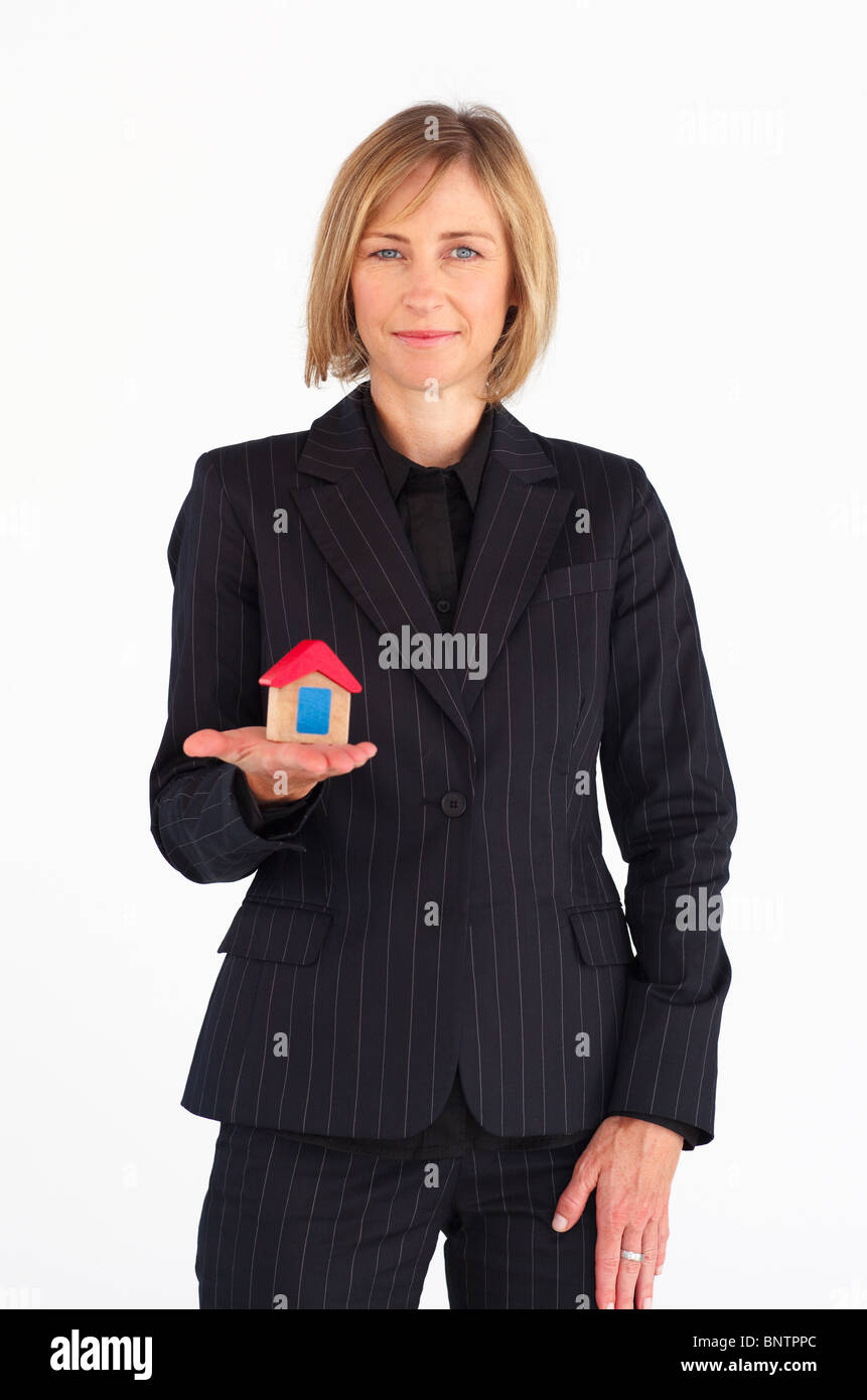 Mature businesswoman holding a house Stock Photo