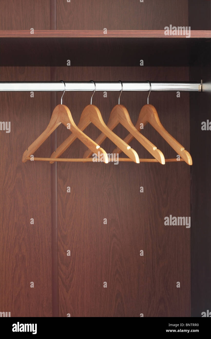 empty closet with hangers. Wooden Hangers Hanging In An Empty Closet On The Upper With A