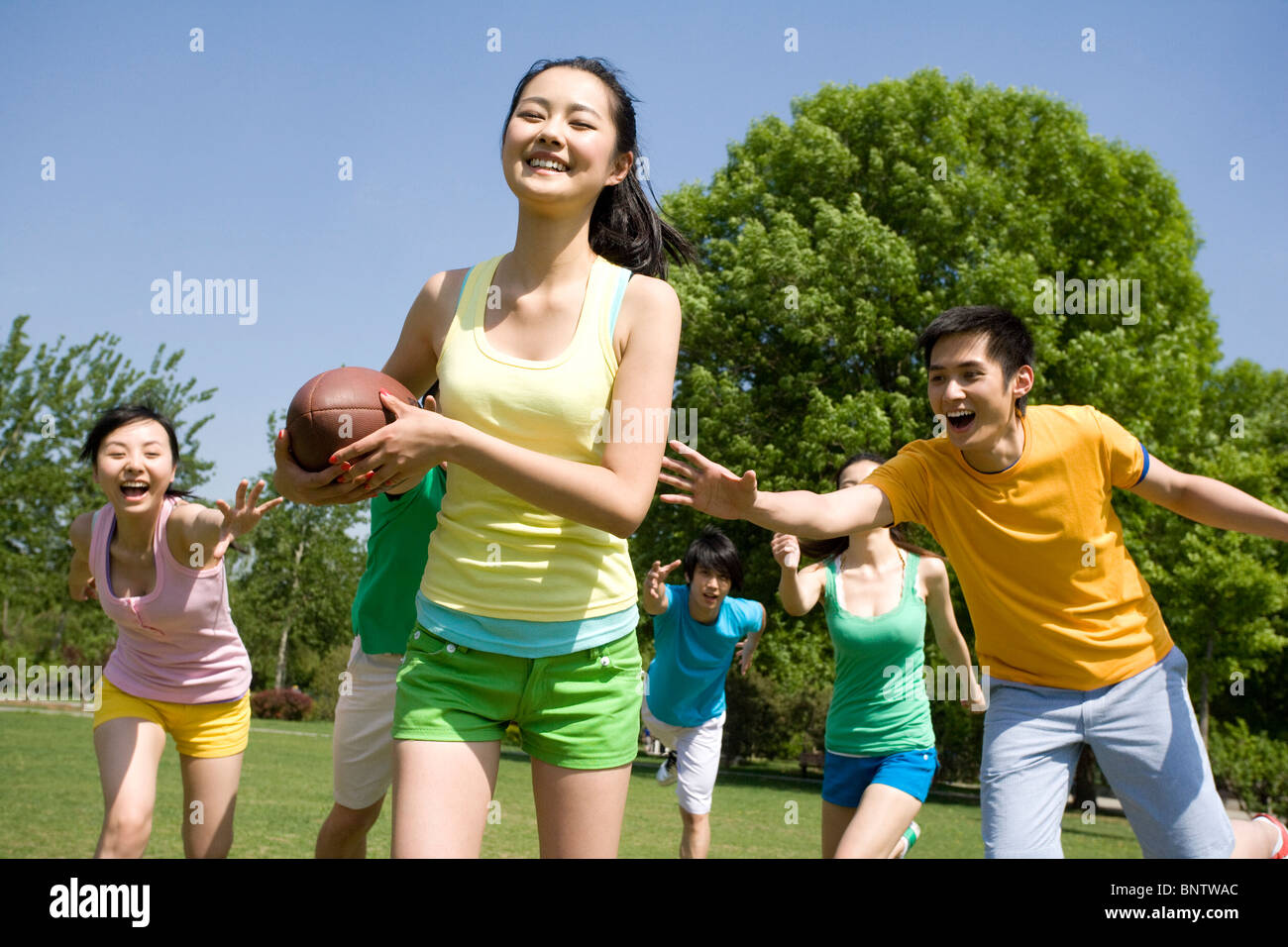 Group of friends playing American Football Stock Photo ...