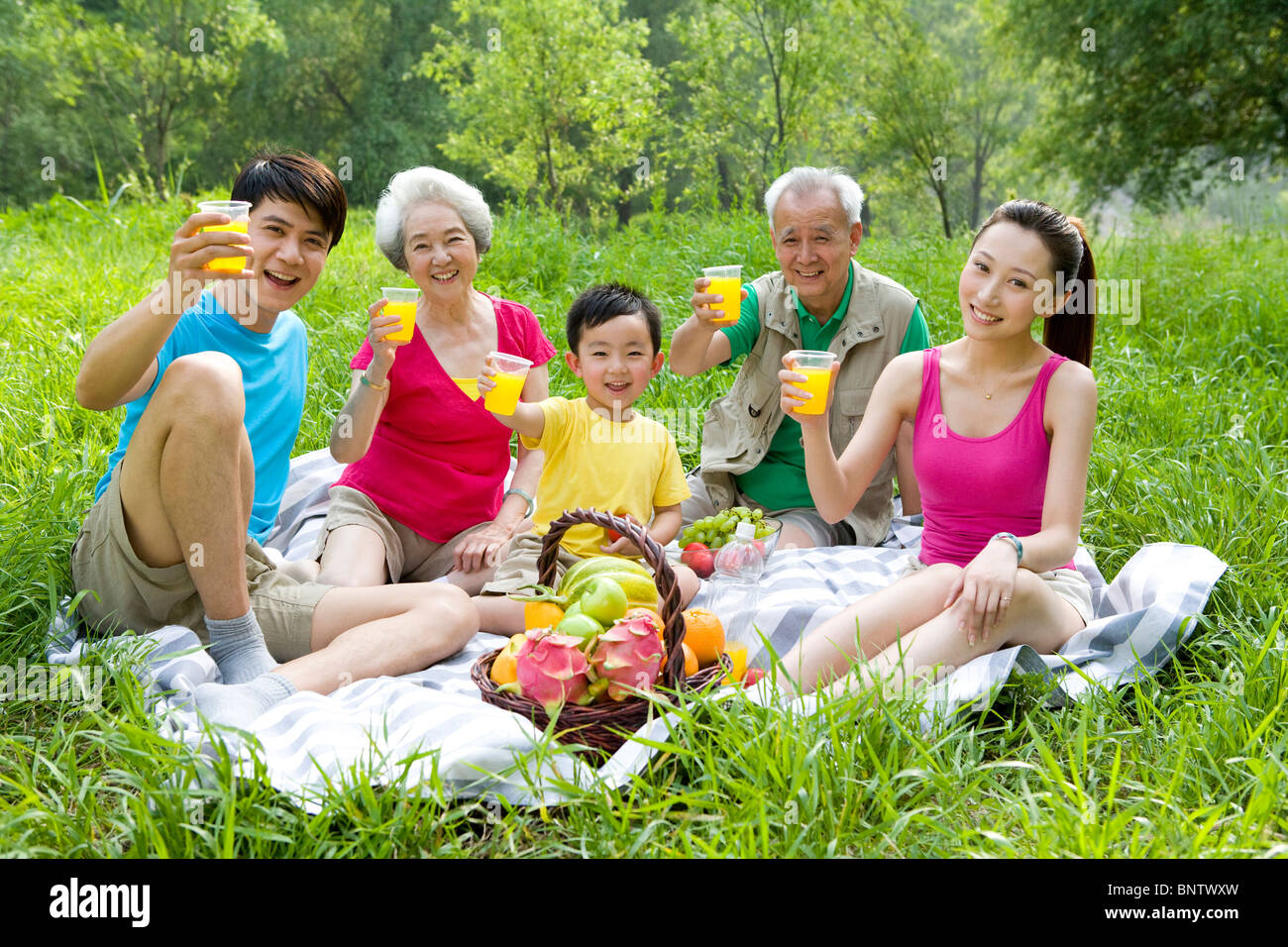 Portrait of a family picnicking - Stock Image