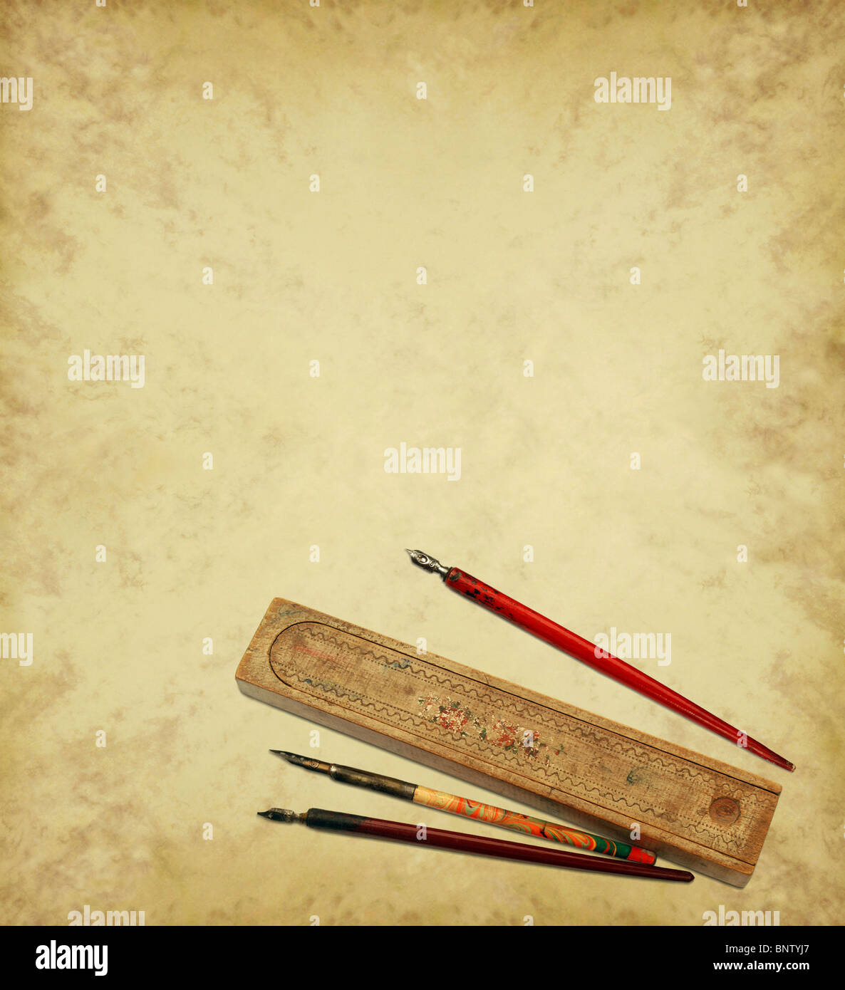 Parchment background with old pens - Stock Image