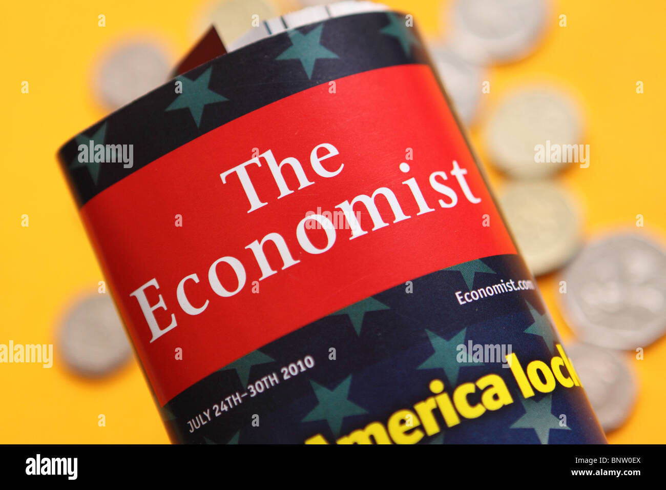 The Economist magazine publication cover with money coins - Stock Image