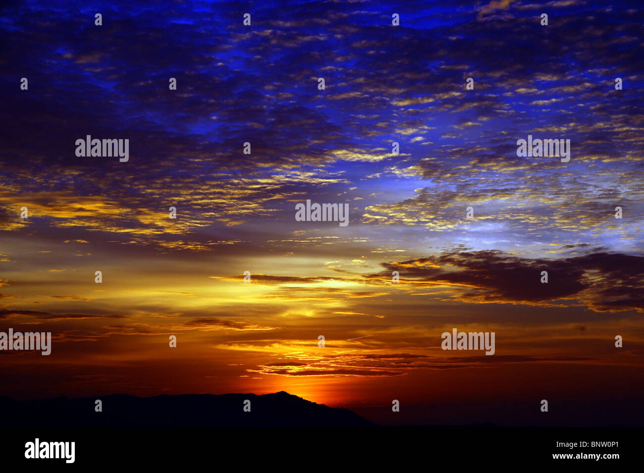 Sunset with a kind on mountains Matang from height of the bird's flight. Malaysia. Borneo. Kuching. - Stock Image