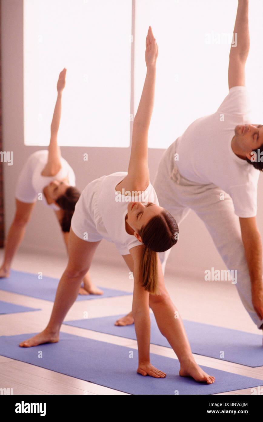 three people stretching on yoga mats stock photo 30669820 alamy