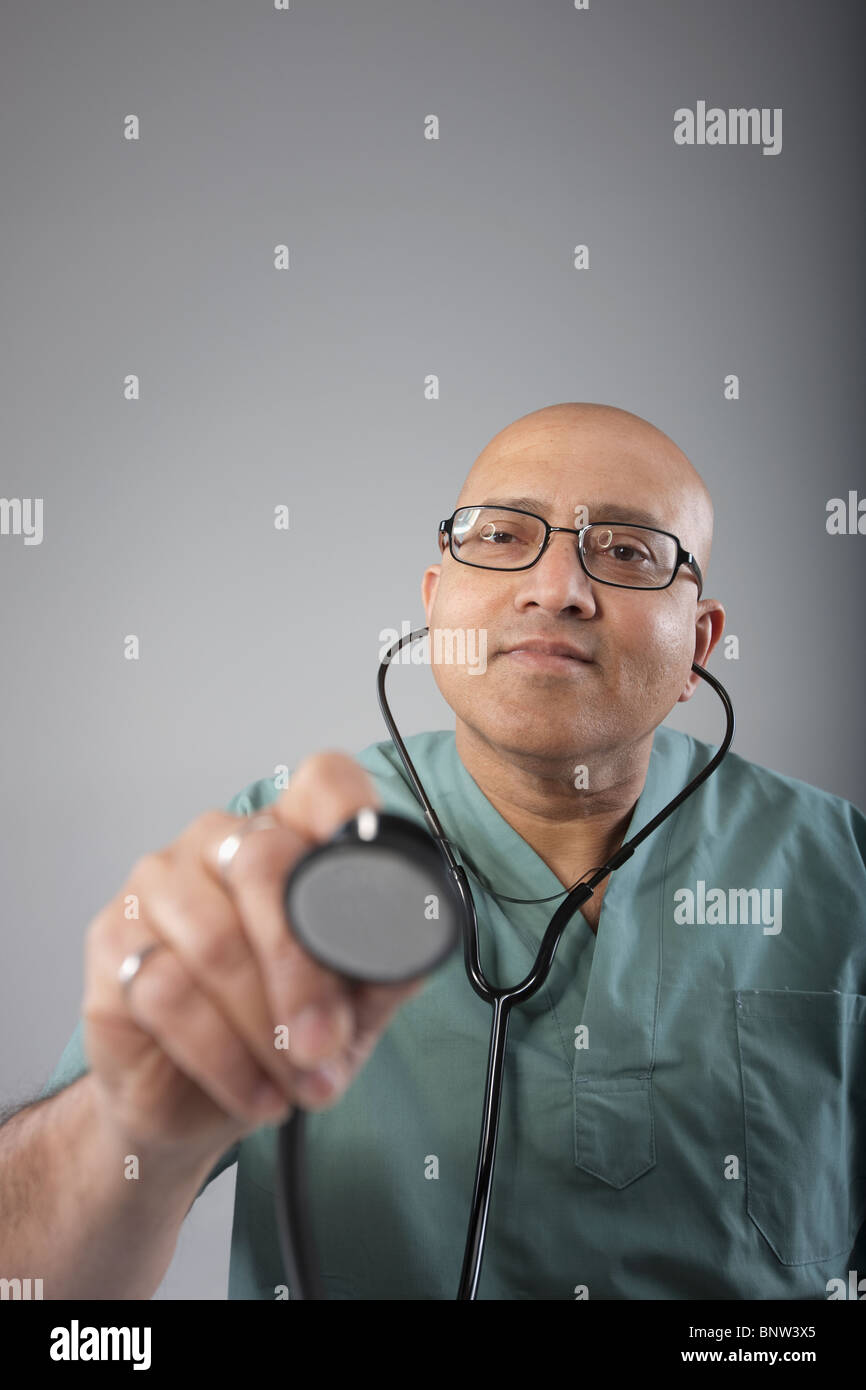 Doctor holding his stethoscope - Stock Image