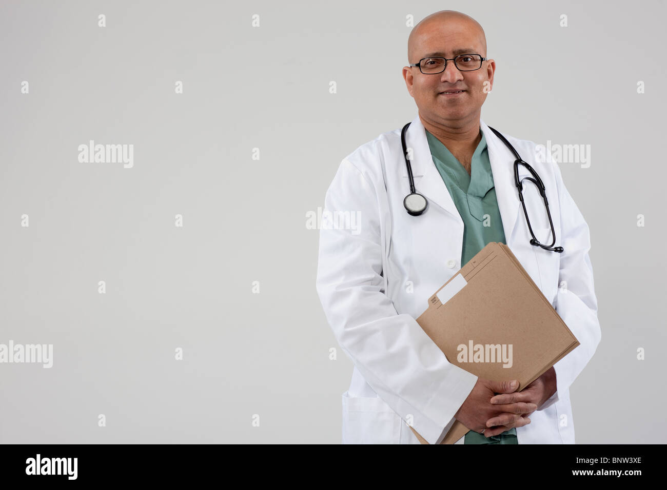 Doctor holding files Stock Photo