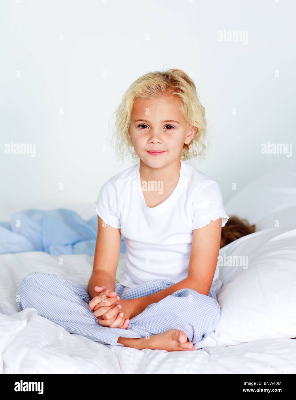 Portrait of a nice girl on a bed - Stock Image