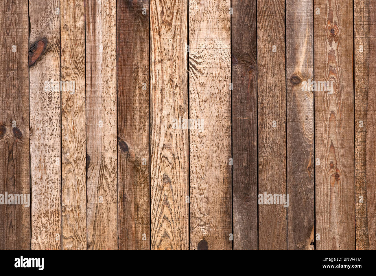 Stained, weathered softwood fence boards - France. - Stock Image
