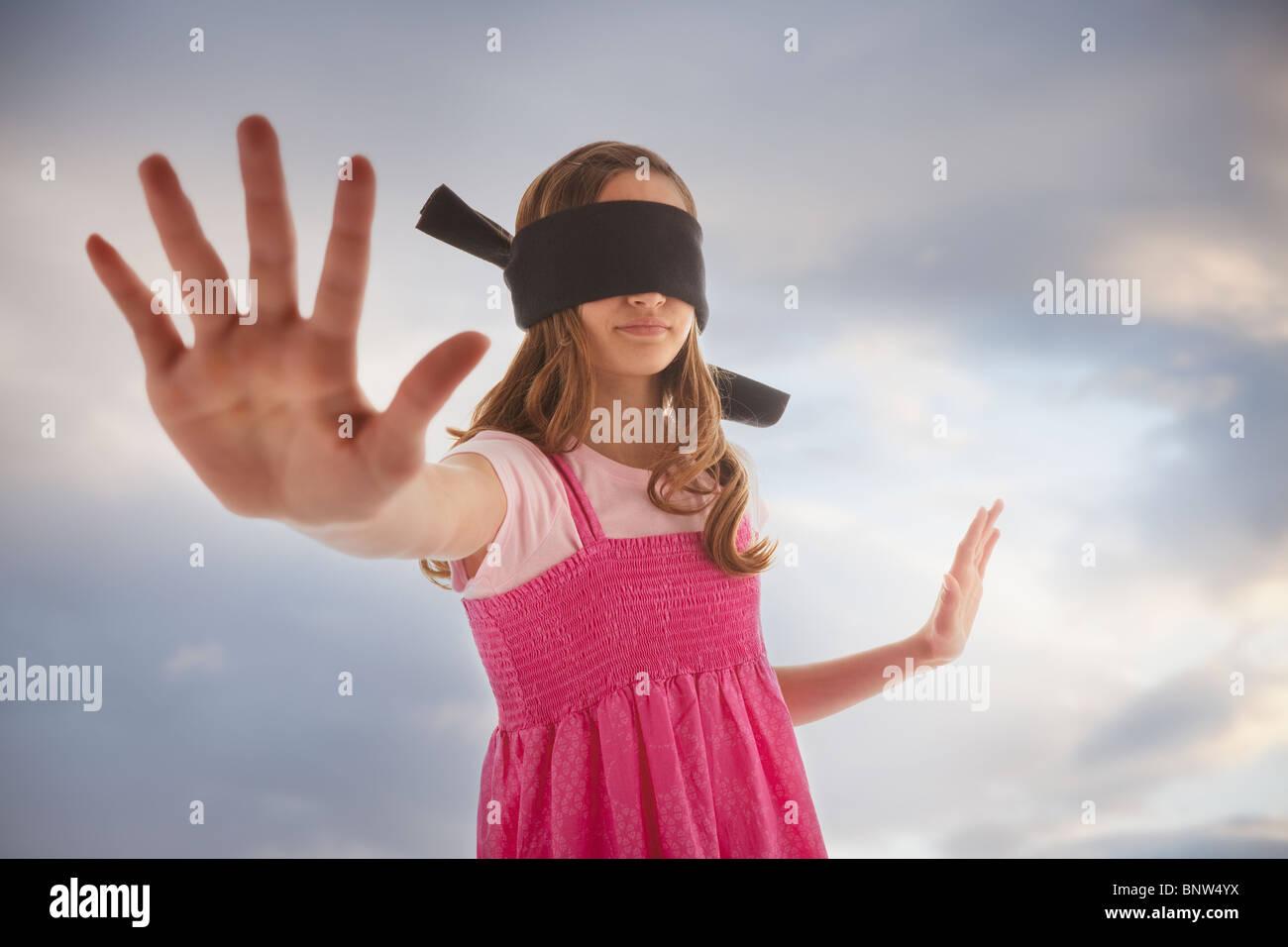 Blindfolded teenage girl - Stock Image