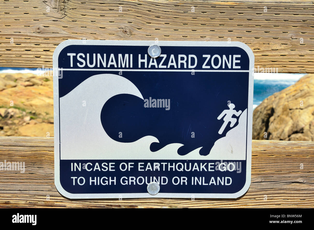 Tsunami Hazard Zone sign in case of earthquake go to high ground or inland Stock Photo