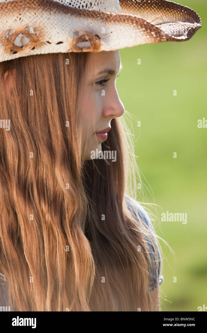 ebf90b8125f Side profile of a beautiful long haired cowgirl - Stock Image