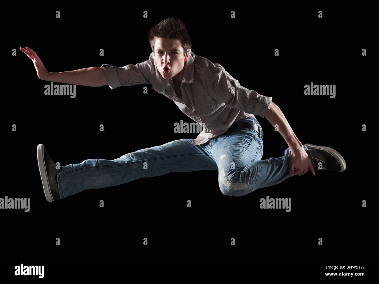 Male dancer jumping in the air Stock Photo