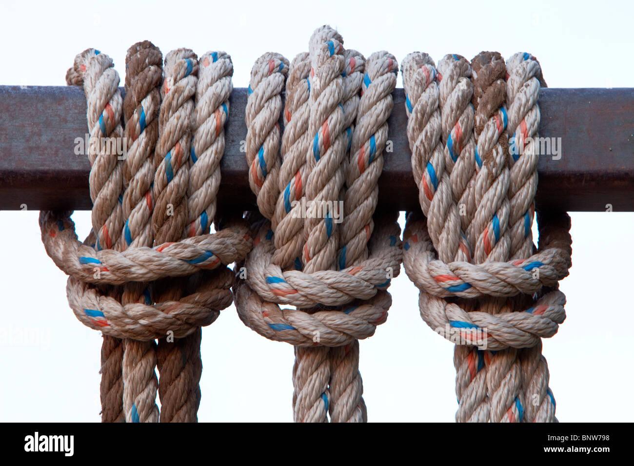 Reverse Lark's Head knots over metal bar - Stock Image