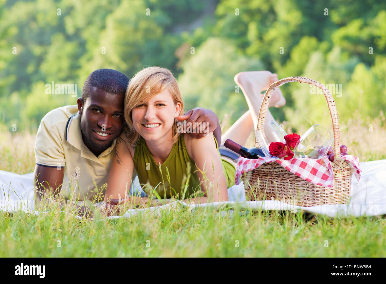 interracial couple picnicking - Stock Image