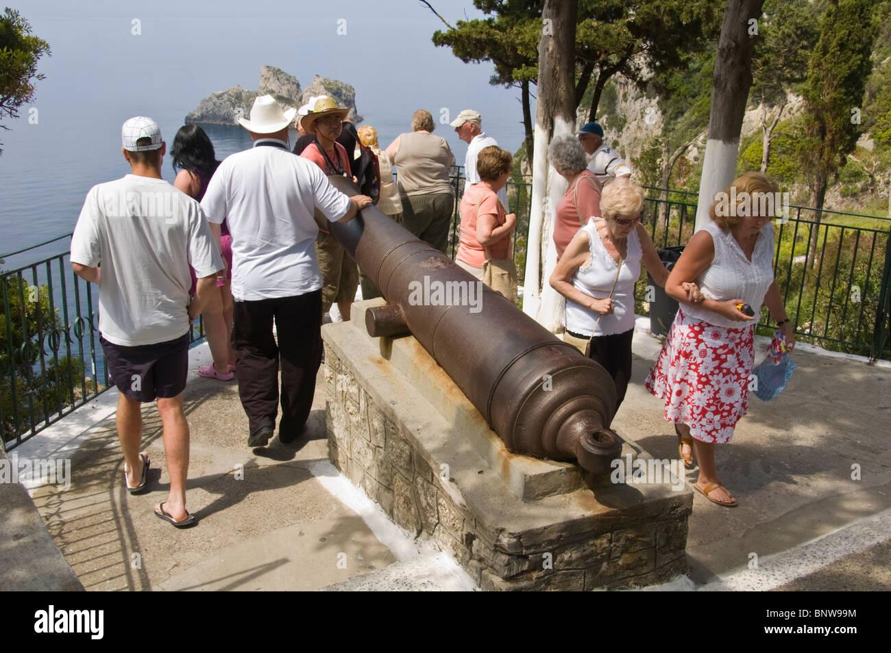 Tourists around the Russian cannon on viewpoint at Paleokastritsa on the Greek island of Corfu Greece GR - Stock Image