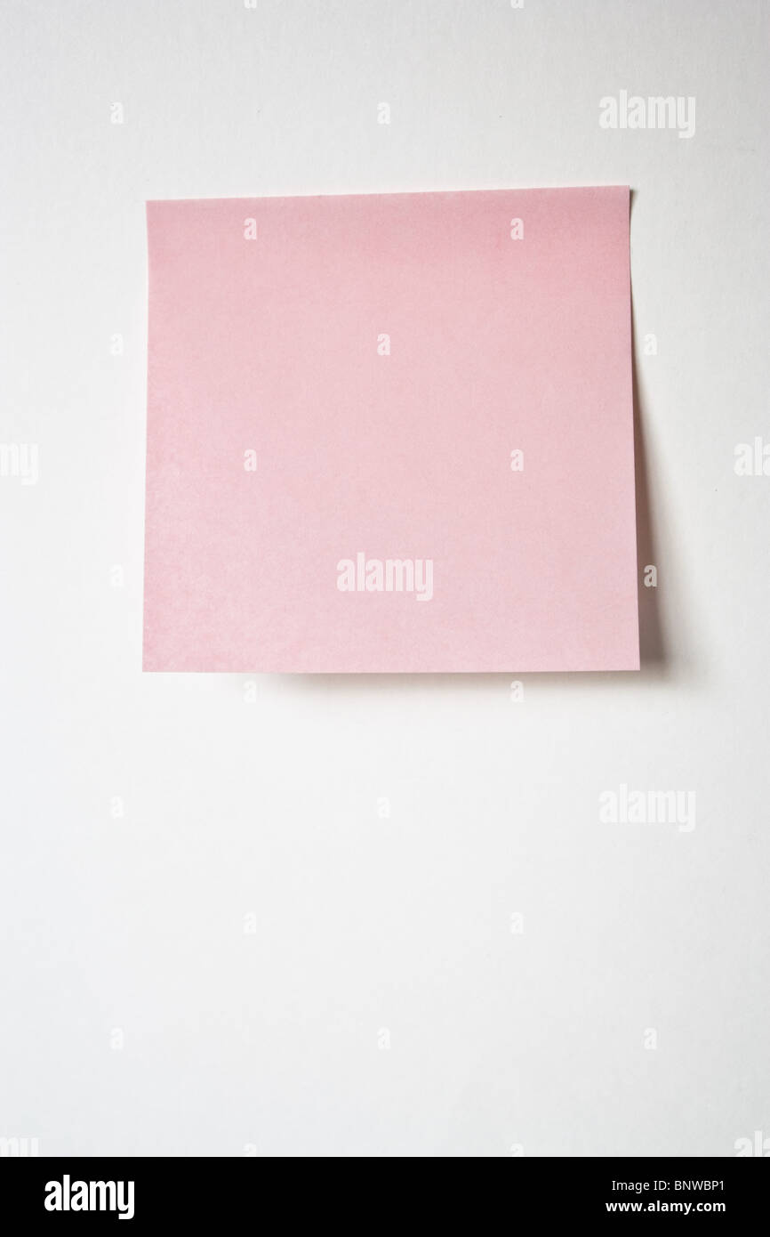 pink postit post-it note memo office - Stock Image
