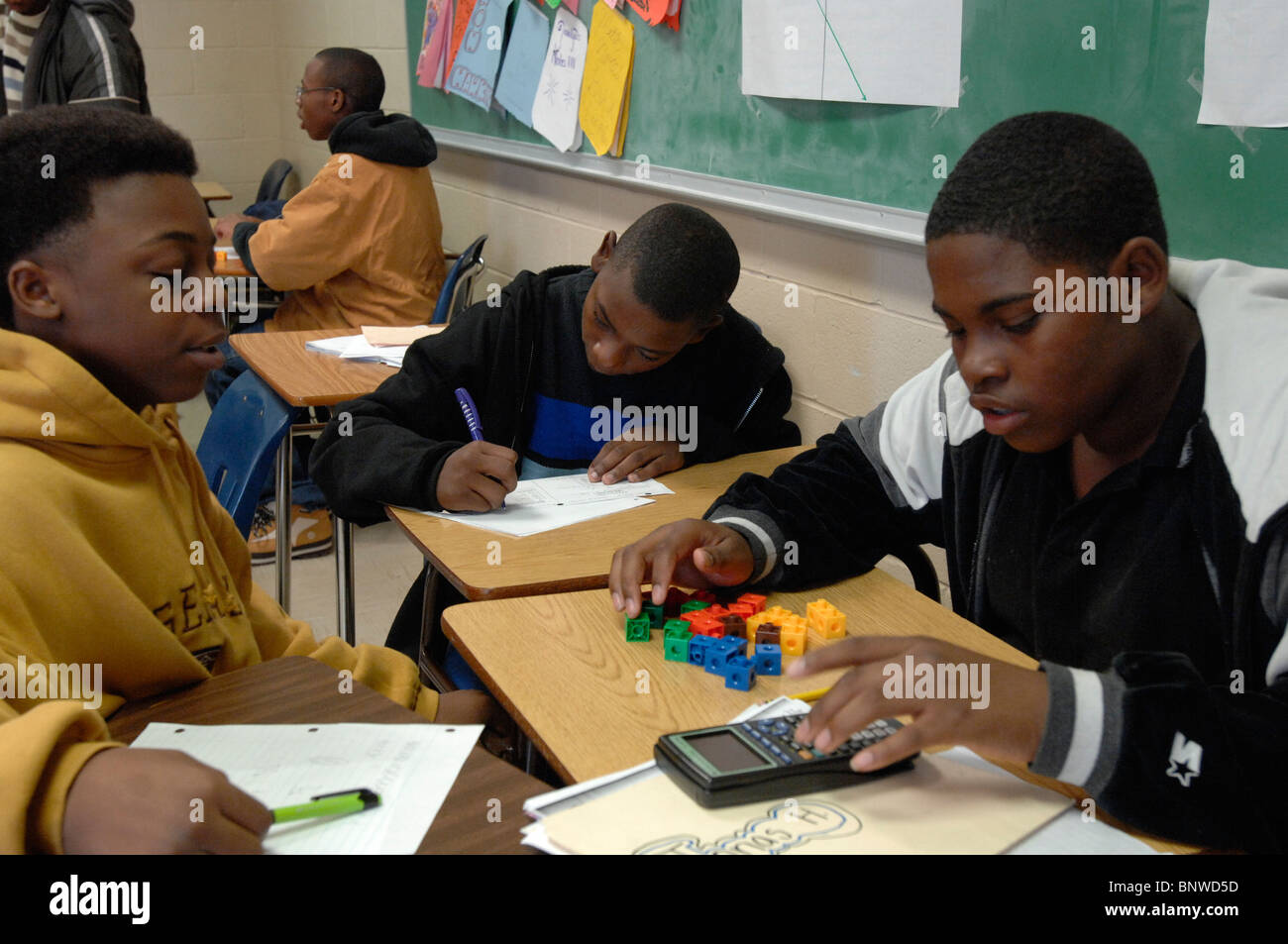Ninth grade African-American boys work on probability problems in