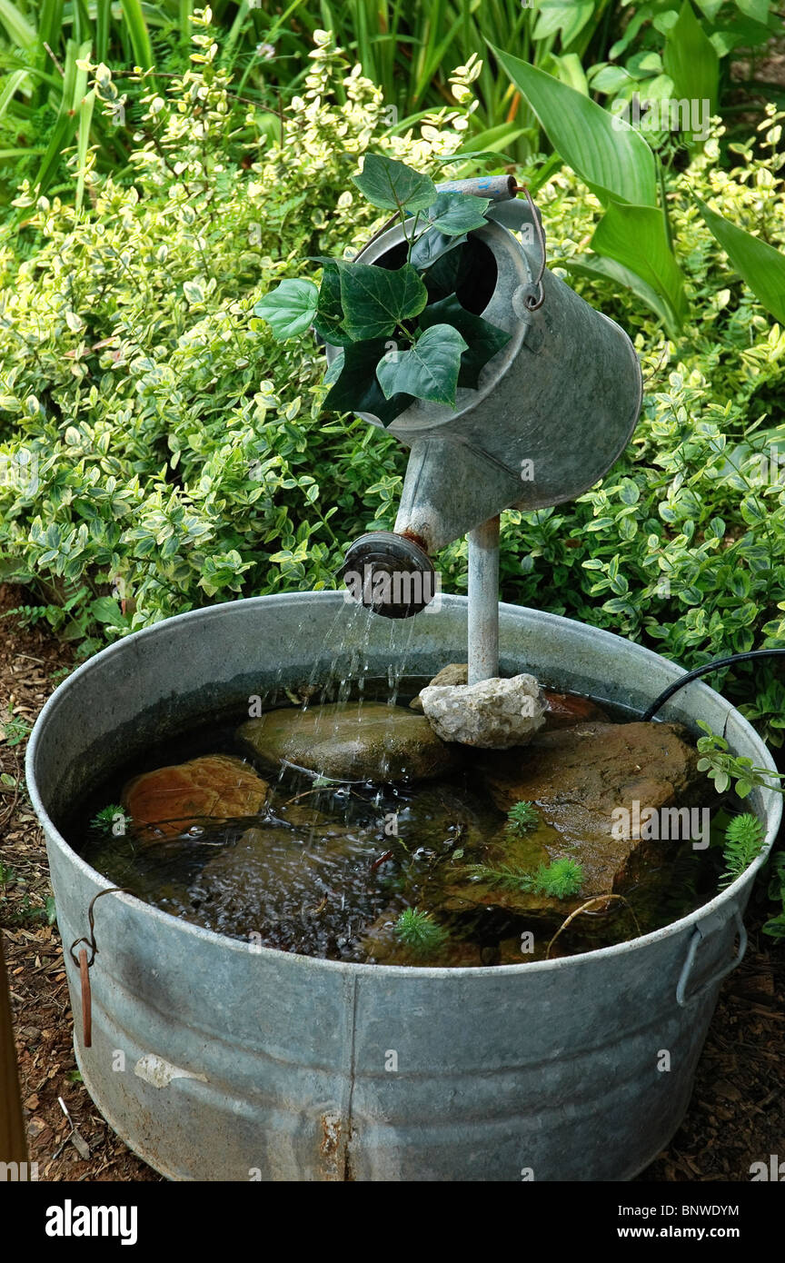 Wash tub and watering can fountain at kentucky communities for Where can i buy fish to stock my pond