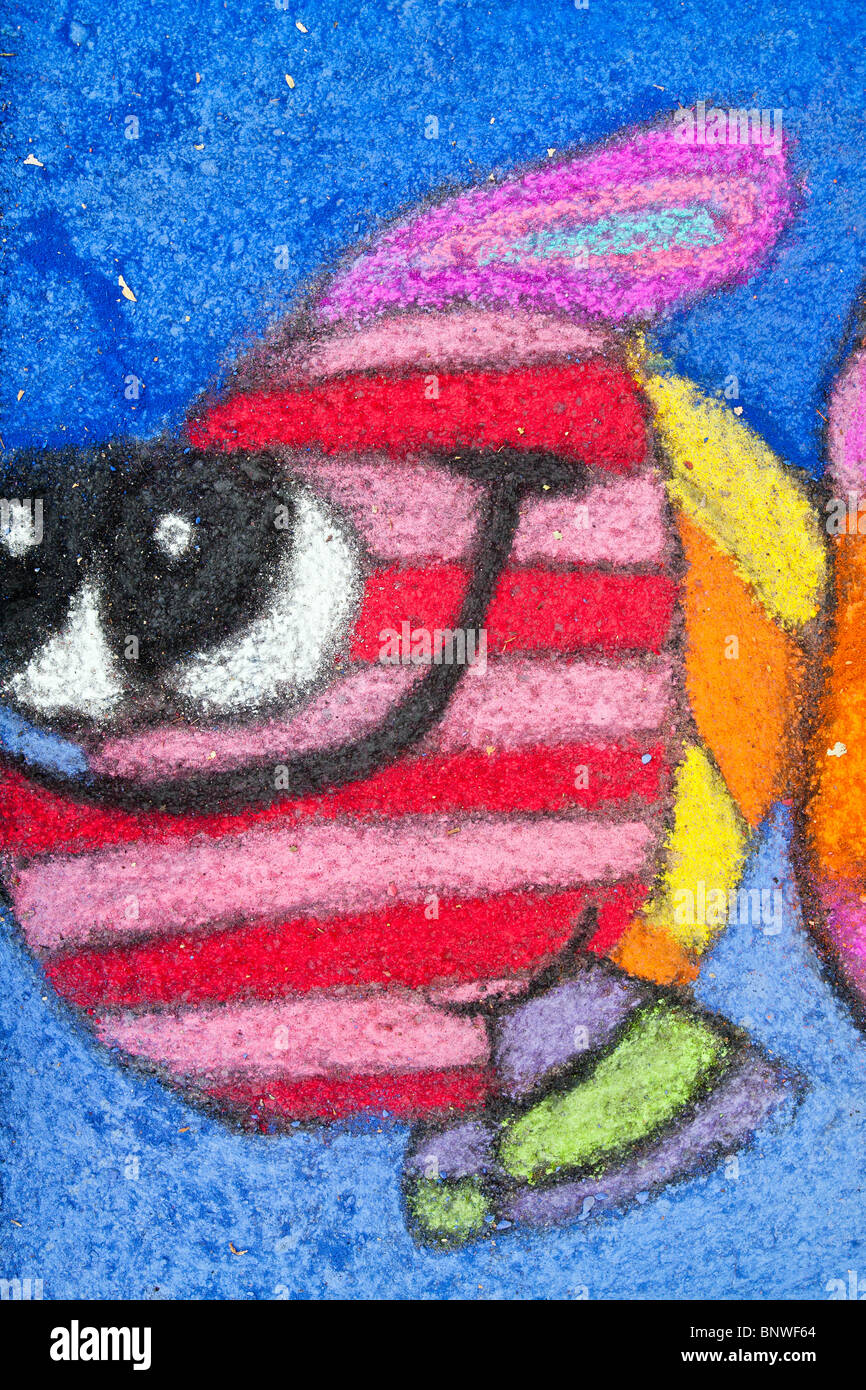 vividly striped fanciful bandit fish swims through cobalt sea in detail of sidewalk chalk drawing at Chalk Art Festival - Stock Image