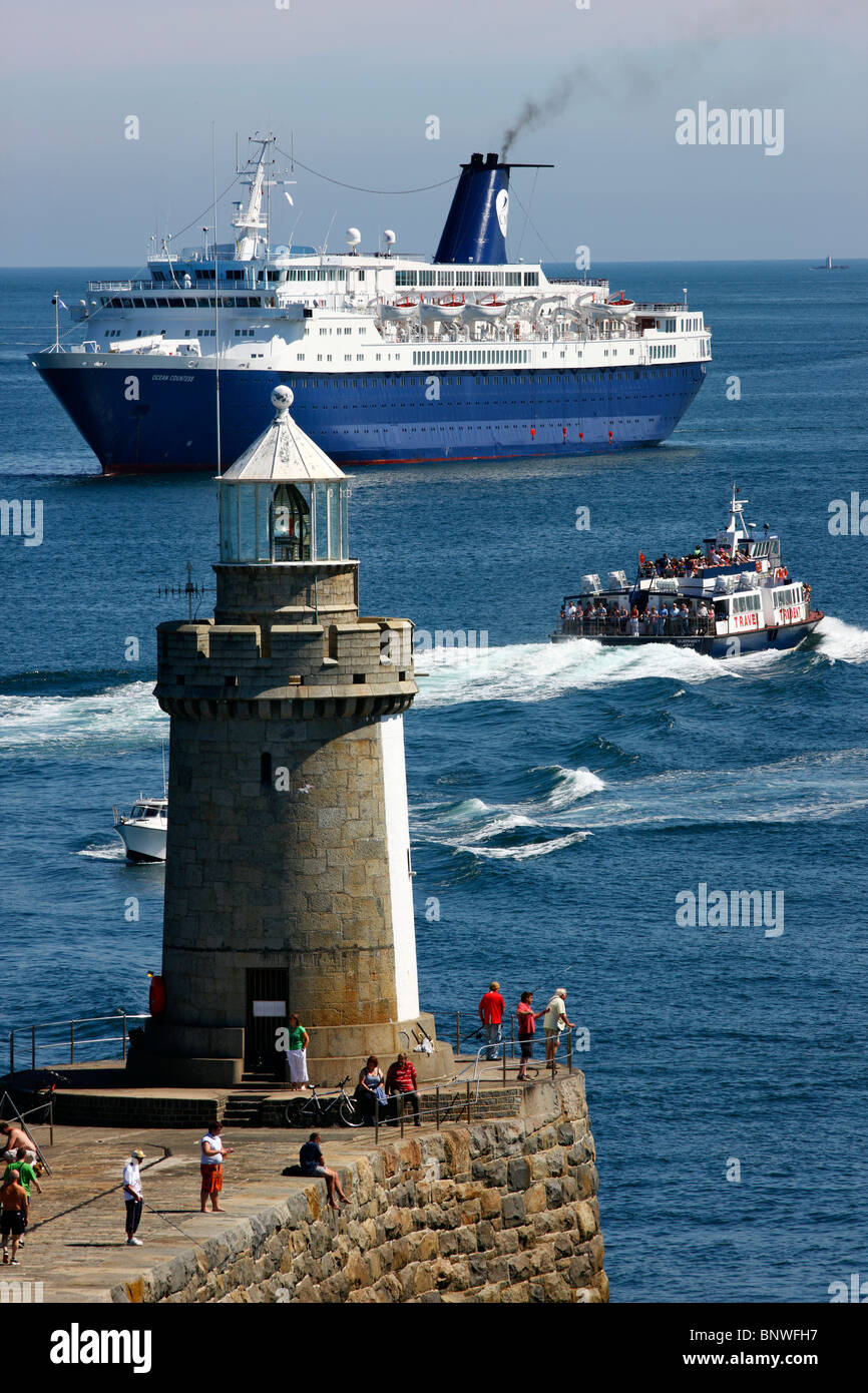 pier and lighthouse of st peter port guernsey british channel
