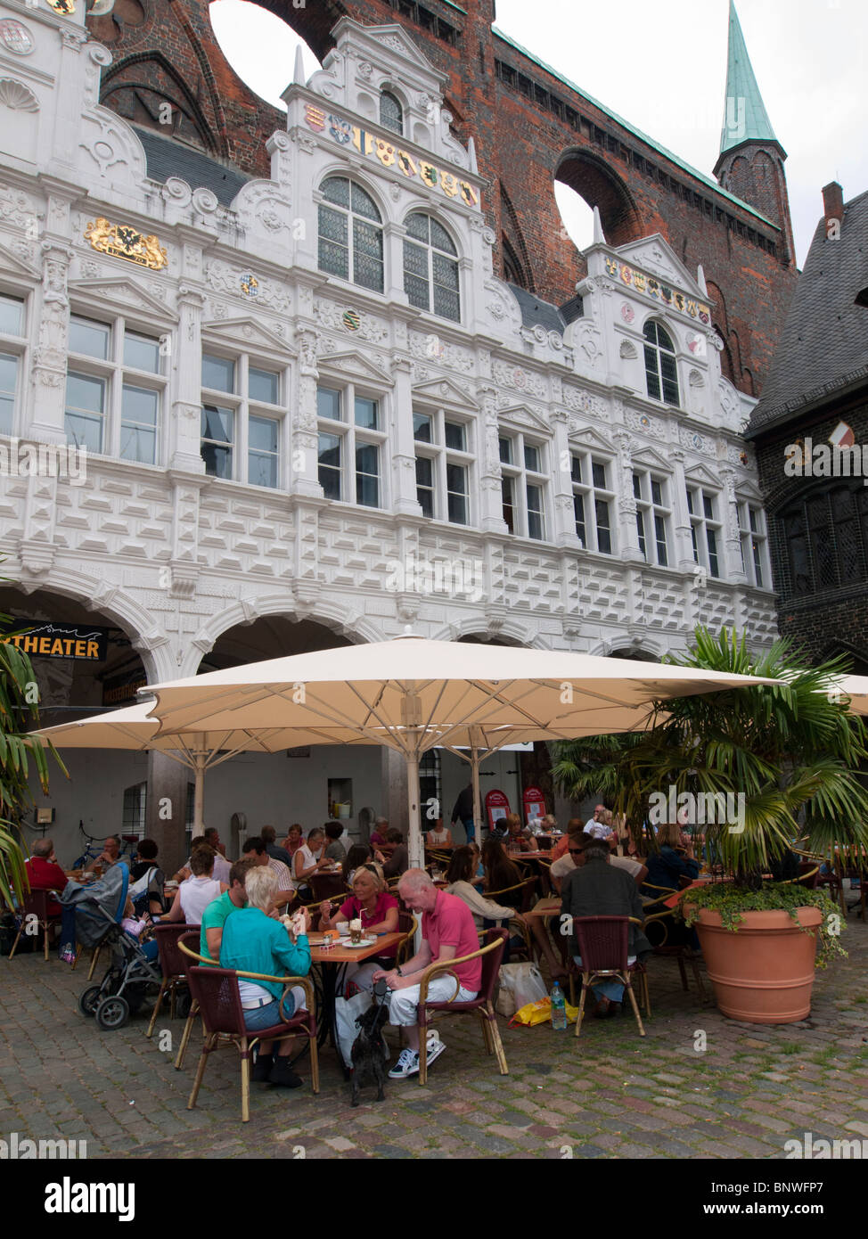 Cafe beside Rathaus or Town Hall  in city of Lubeck in Germany - Stock Image