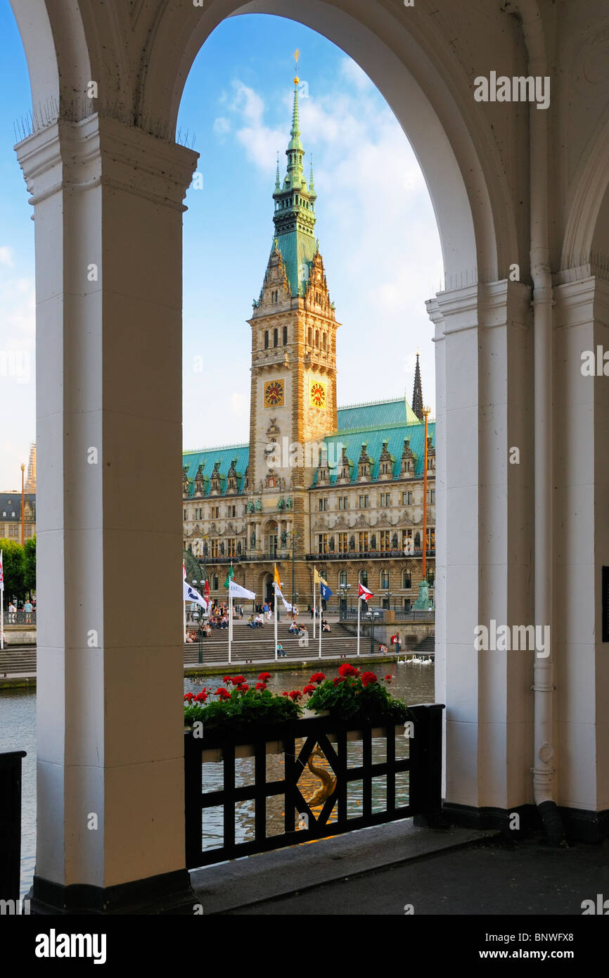 The evening sun shining onto the clock tower of the city hall in Hamburg, Germany. - Stock Image