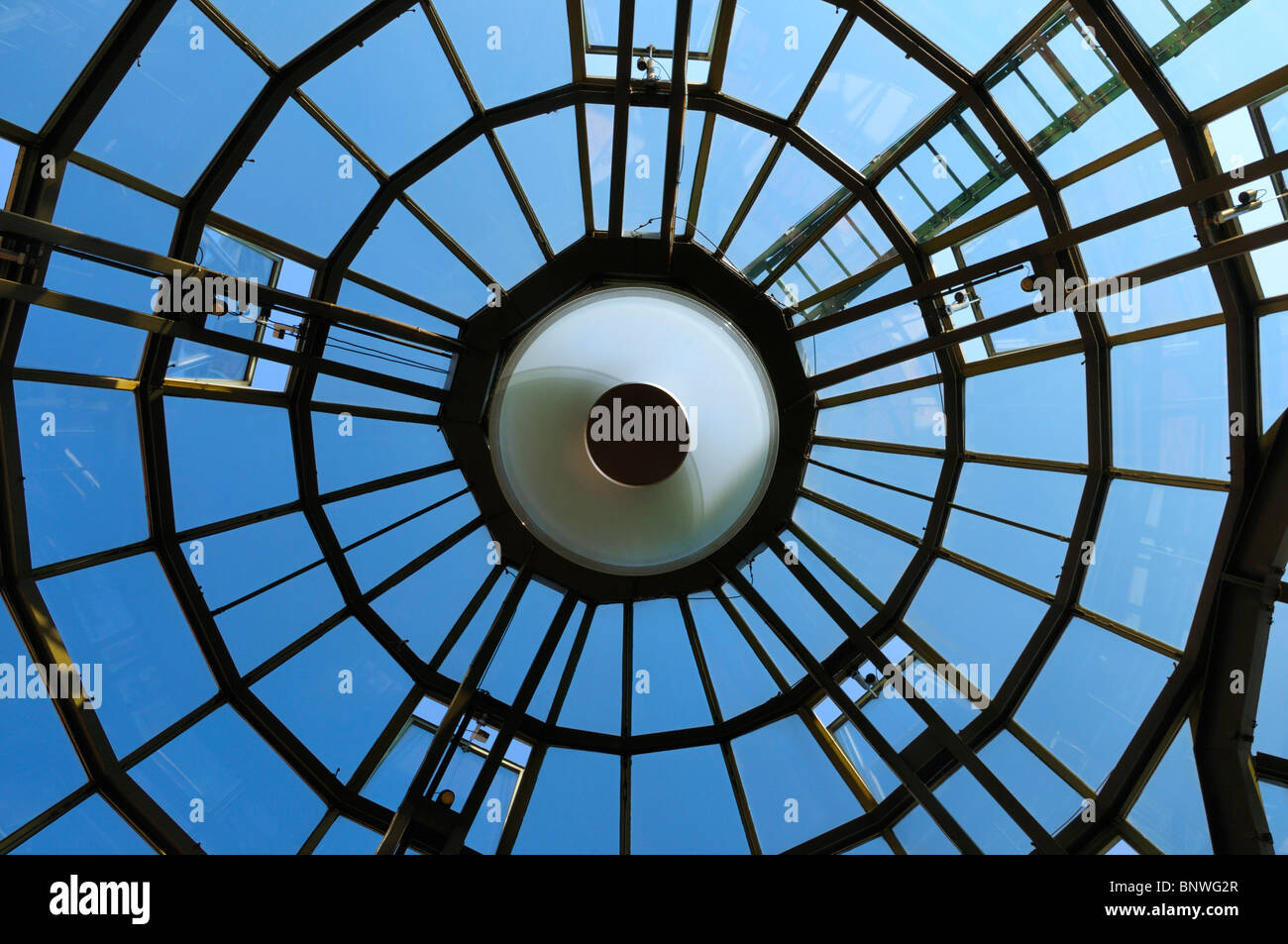 Straight up inside view at parts of the glass roof of a shopping center in Hamburg, Germany. - Stock Image
