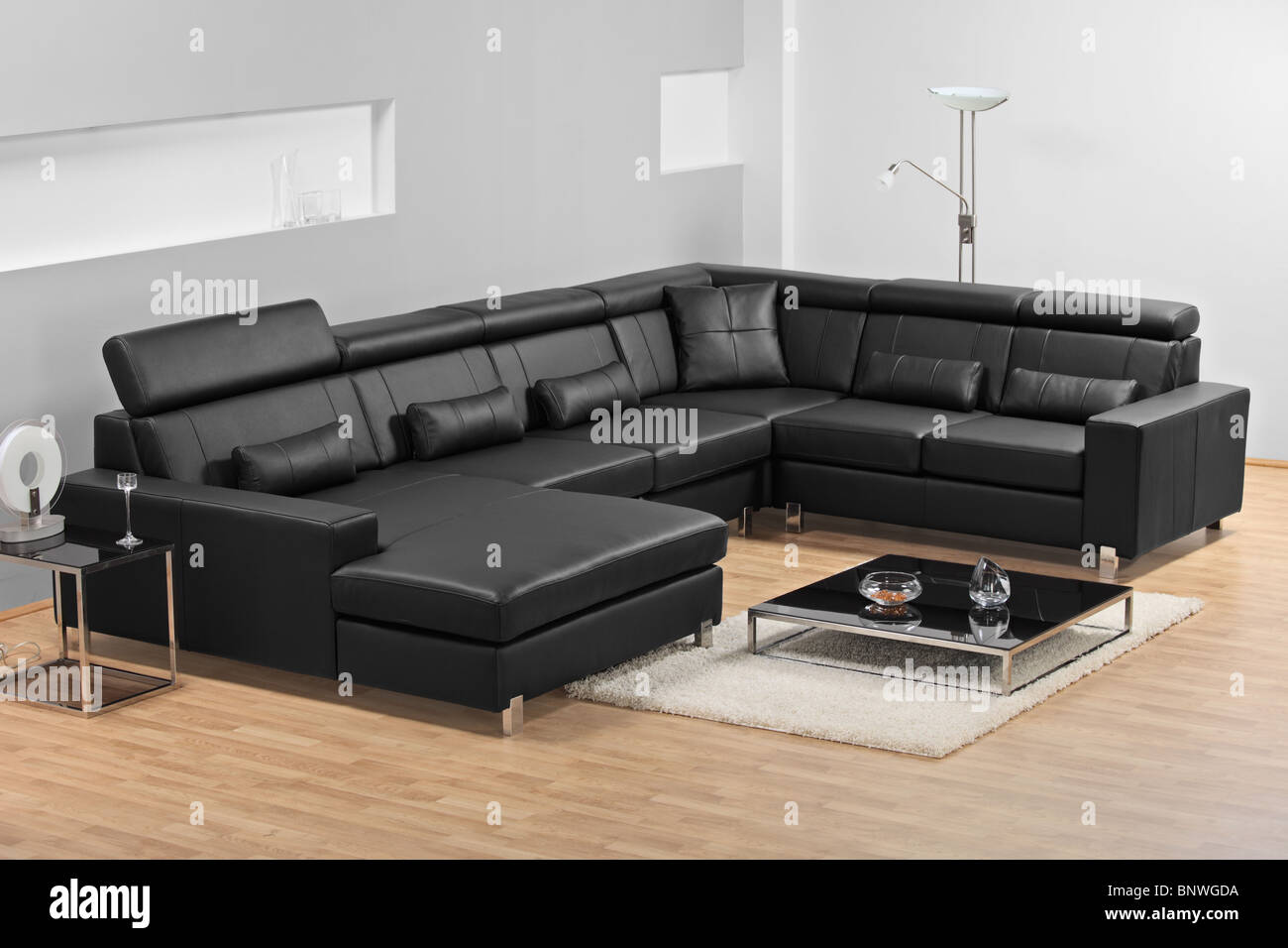A view of a modern apartment with black leather sofa Stock Photo