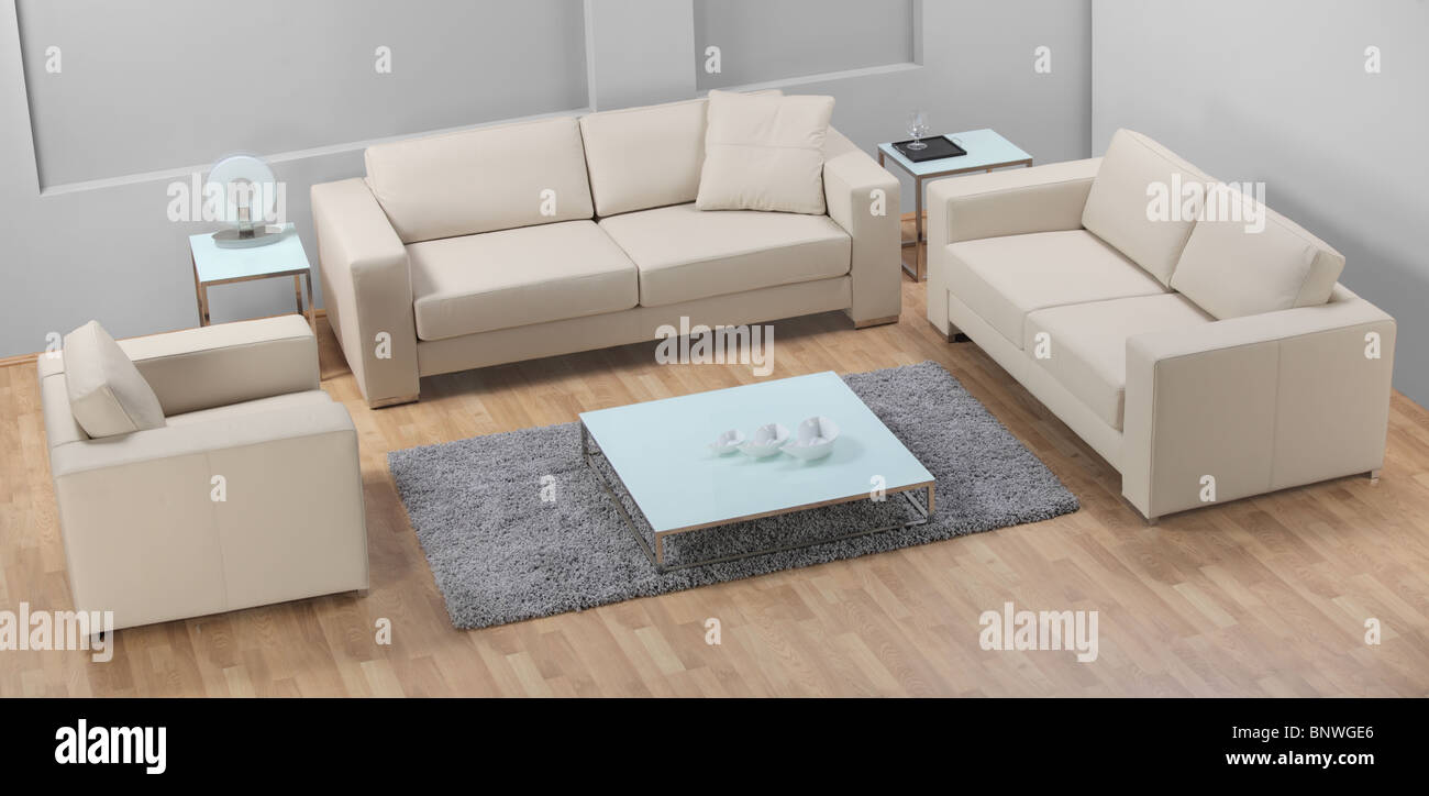 A view of modern leather white sofa - Stock Image