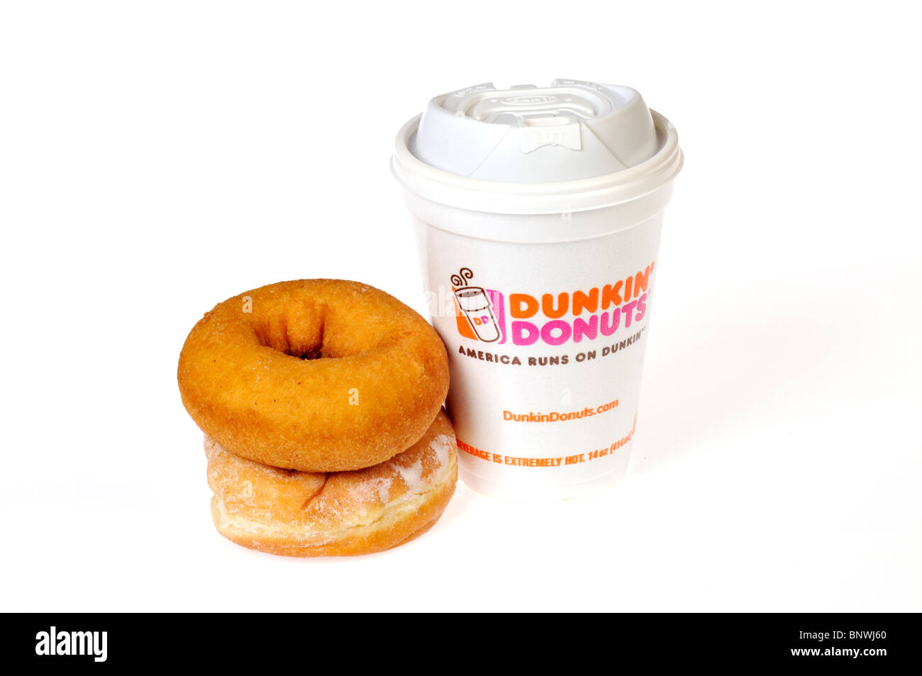 A hot styrofoam cup of Dunkin Donuts coffee with plain and jelly ...
