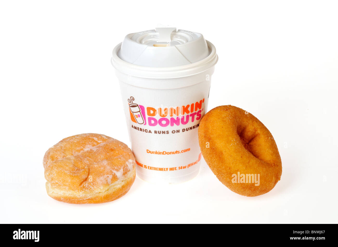 A hot cup of Dunkin Donuts Coffee with a plain and jelly donuts on a ...