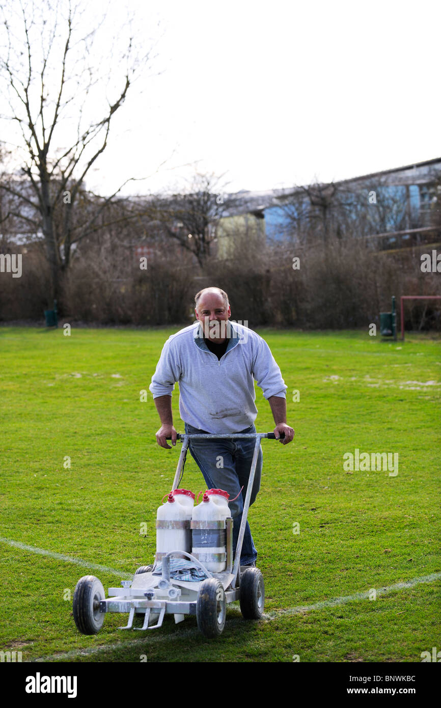 Green Keeper with marking gadget Stock Photo