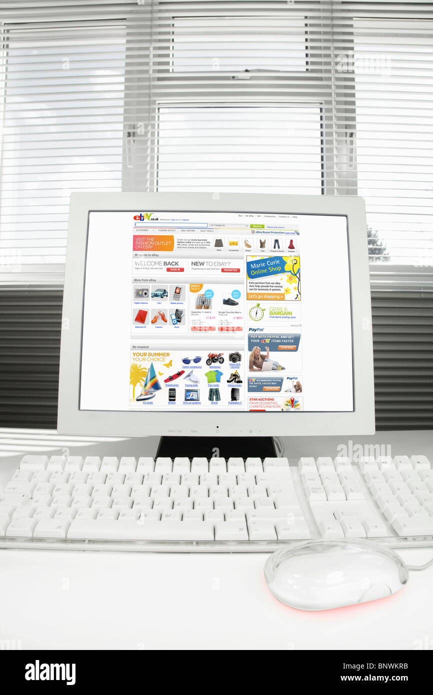 Home Computer with Ebay.co.uk Internet page on the screen - Stock Image