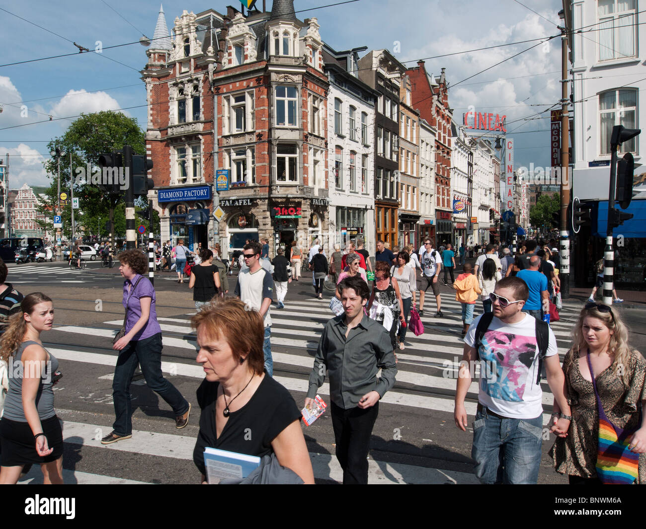 Busy pedestrian crossing in central Amsterdam The Netherlands - Stock Image
