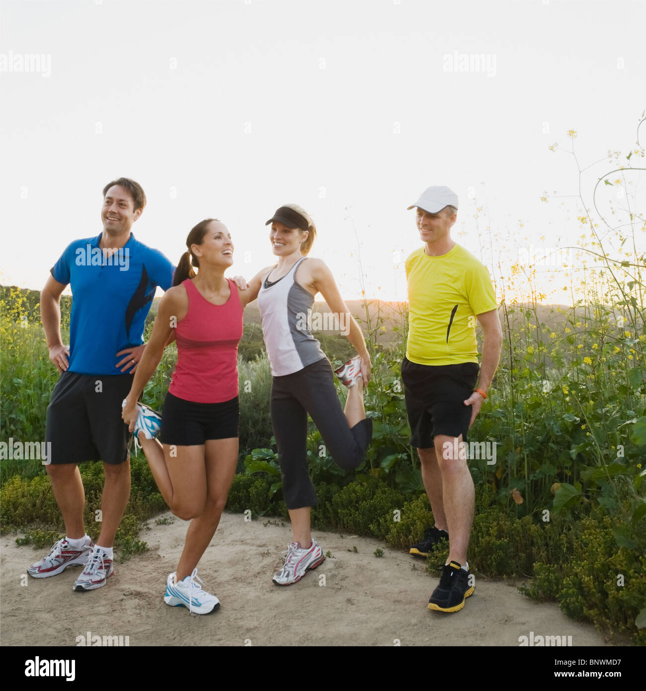 Trail runners stretching - Stock Image
