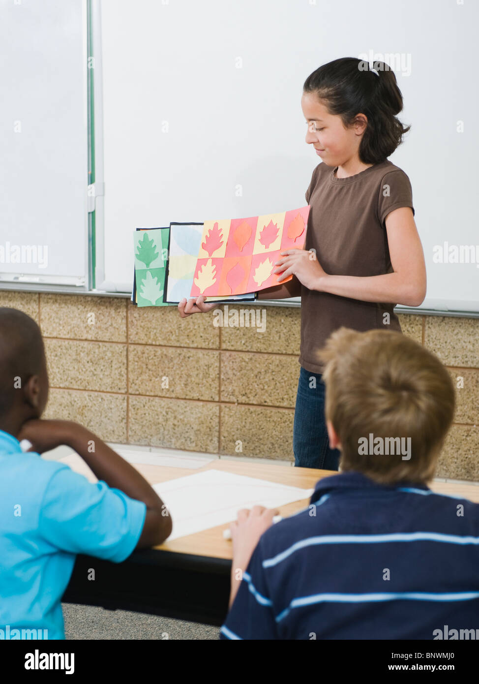 Elementary student giving class presentation - Stock Image