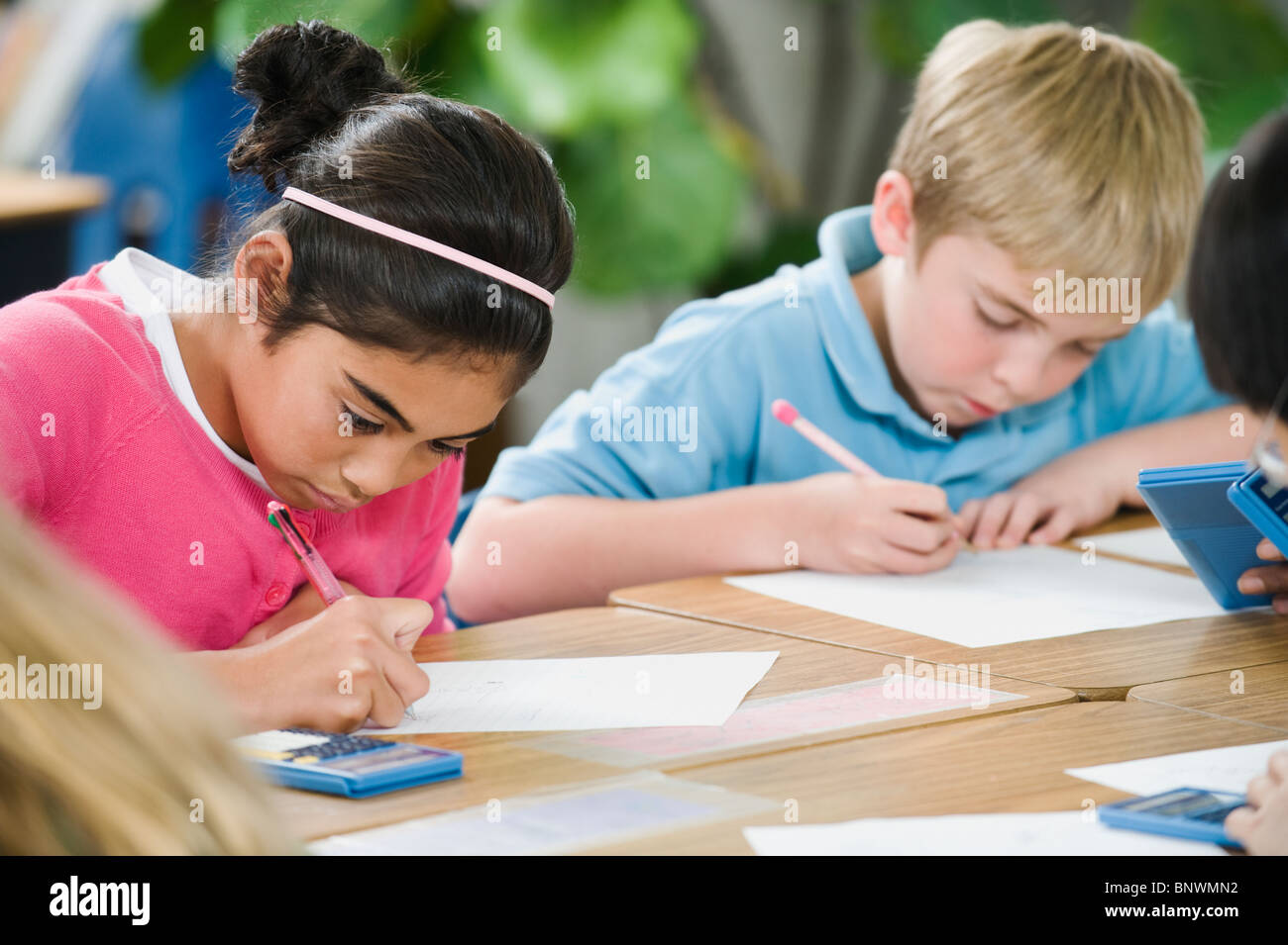 Students doing math work in classroom Stock Photo: 30683214 - Alamy