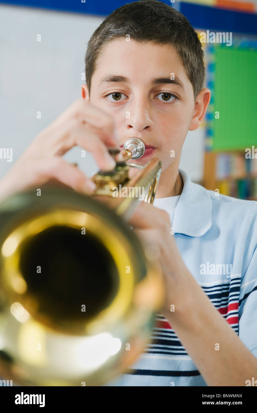 Elementary school student playing trumpet - Stock Image