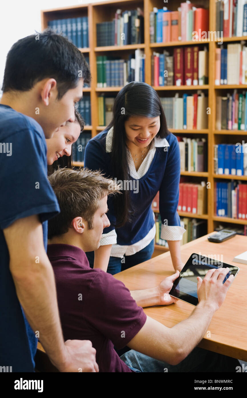 College students looking at electronic book - Stock Image