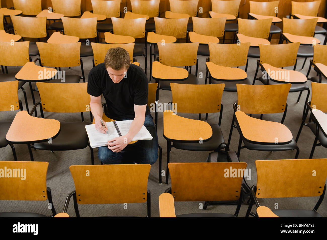 Last student left in college lecture hall - Stock Image